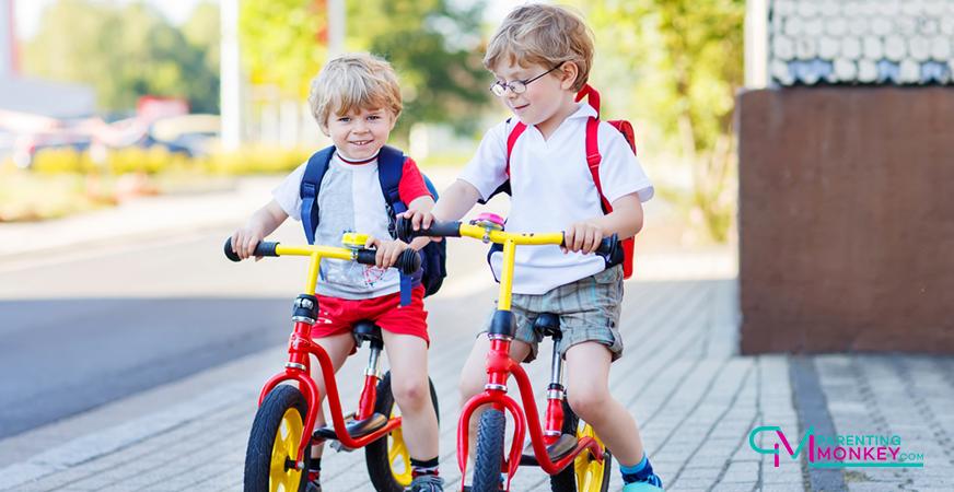 2 boys on balance bikes
