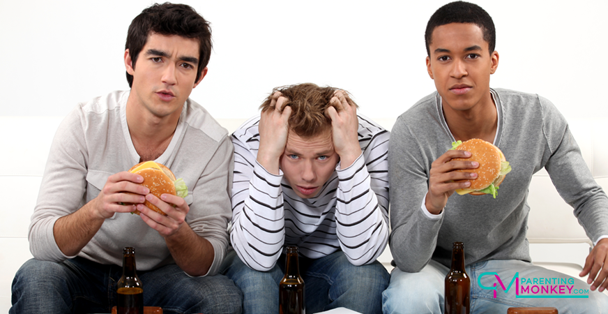 3 teen lads eating burgers