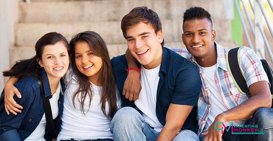 Teenagers sitting on school steps.